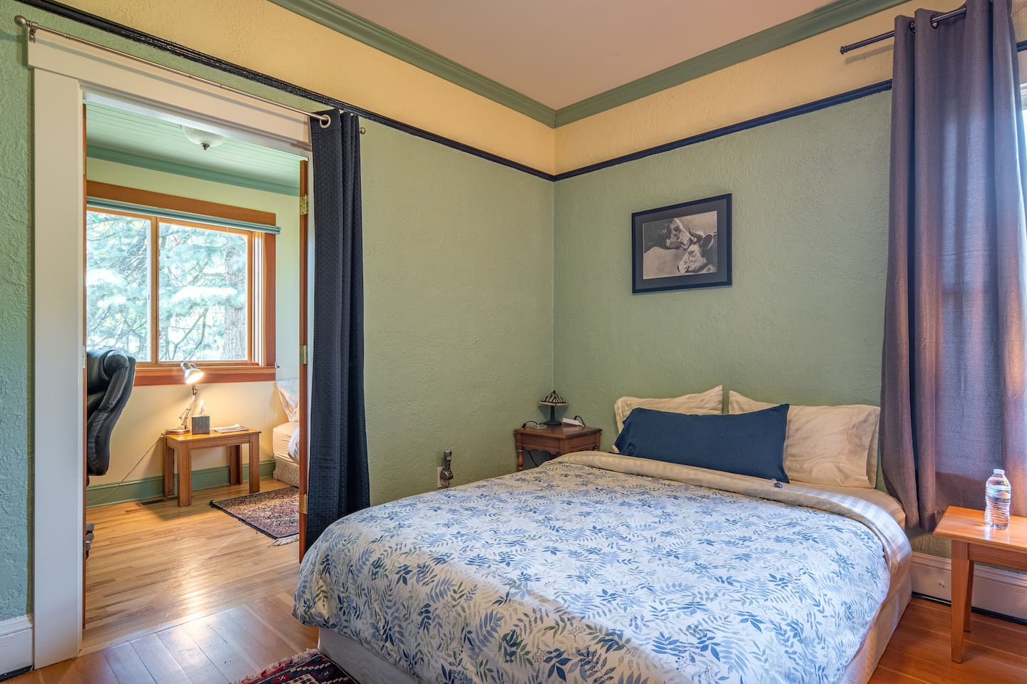 Smaller room has french doors, a privacy curtain & a TwinXL bed (not shown in this photo)
