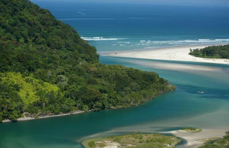 uma das melhores praia do litoral norte o encontro do rio com o mar