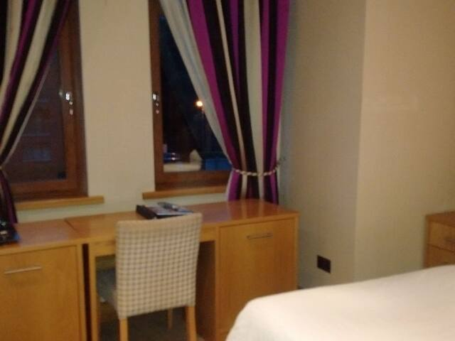 Double room large en-suite with shower- photo showing desk, table and window (Room 4)