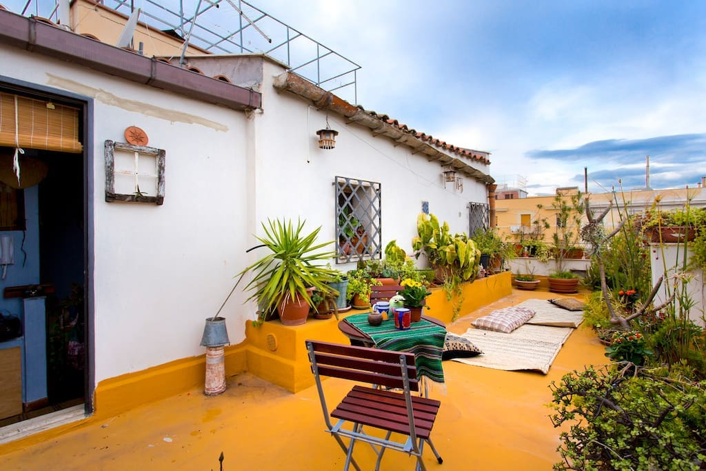 The terrace facing the sea and the roofs of Palermo historical center