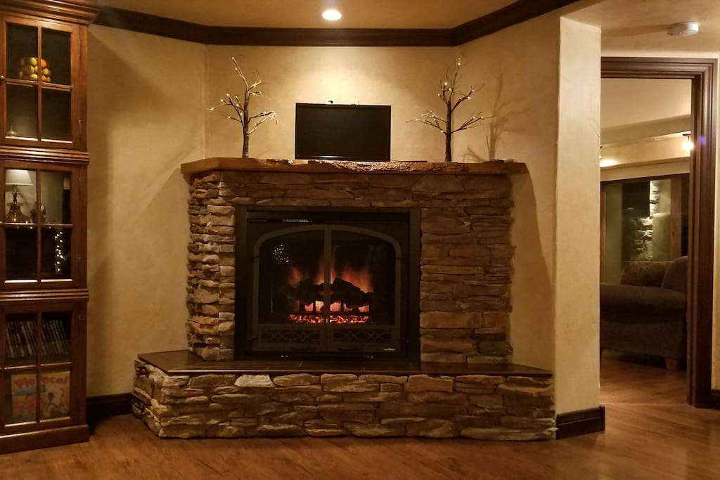 Family room gas fireplace & television.