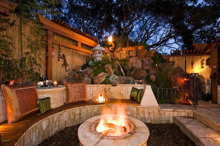 Entertain friends and family around the gas/wood-burning firepit. Its sunken disposition keeps you warm and cozy at night.