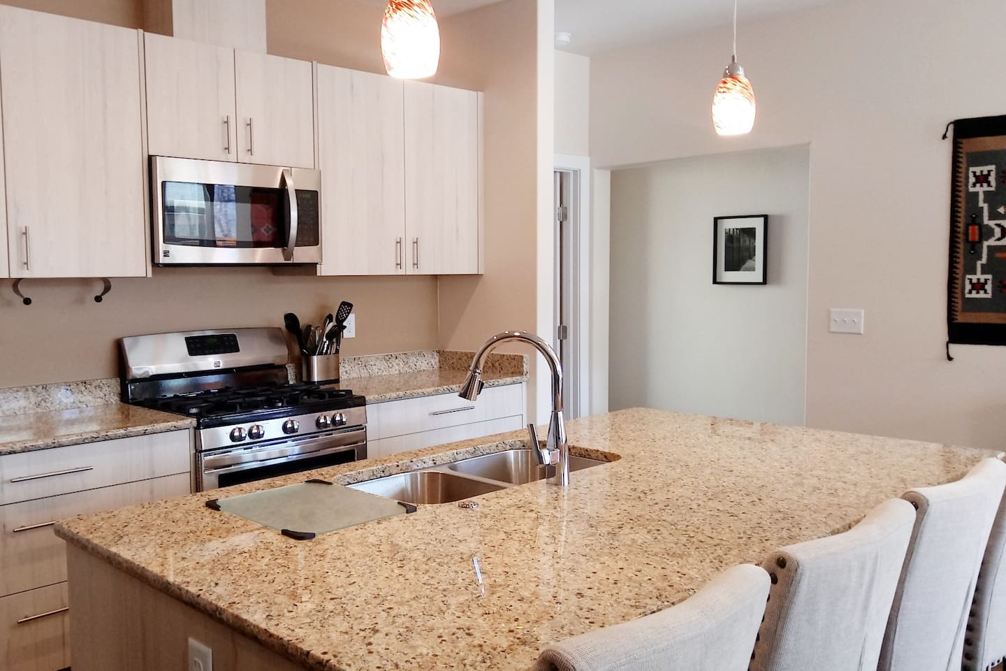 Spacious well appointed kitchen with with new upscale appliances / gas stove. Ice maker, coffee maker, many spices, and assortment of kitchen utensils etc.