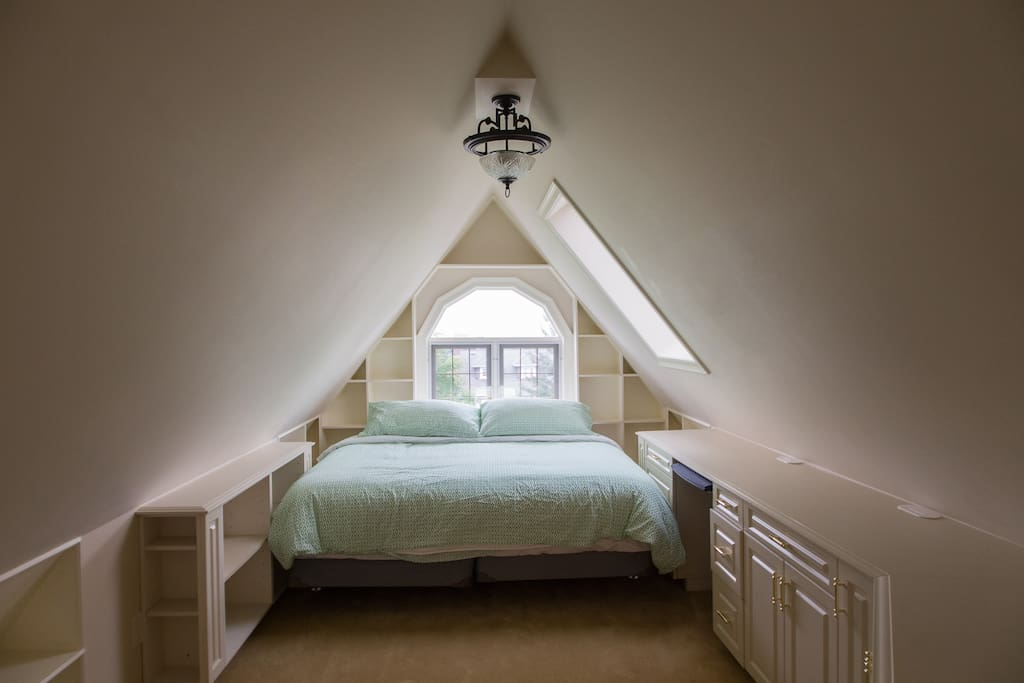 Cozy and spacious.  King sized bed with view, skylight & fireplace