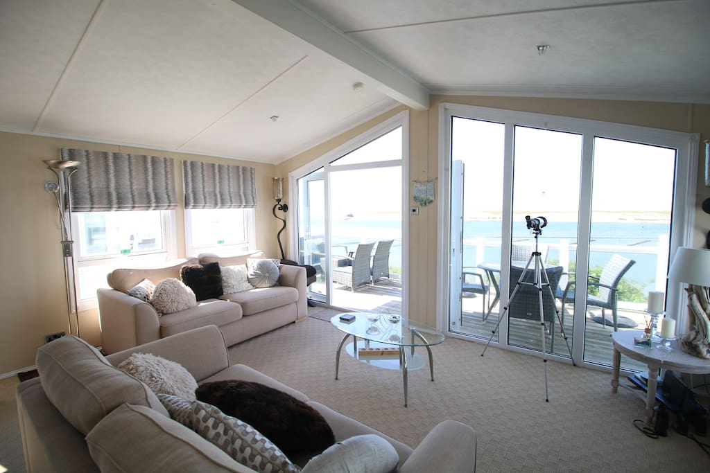 The living area, with panoramic views over the Fleet Lagoon.