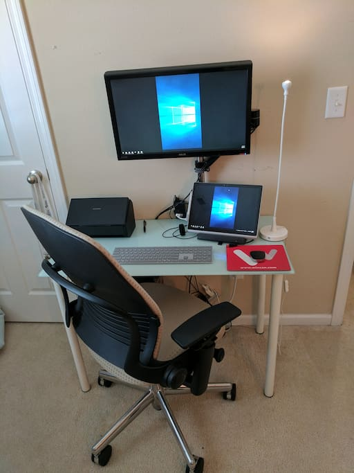 Work area with second monitor and laptop stand for you to use with your laptop
