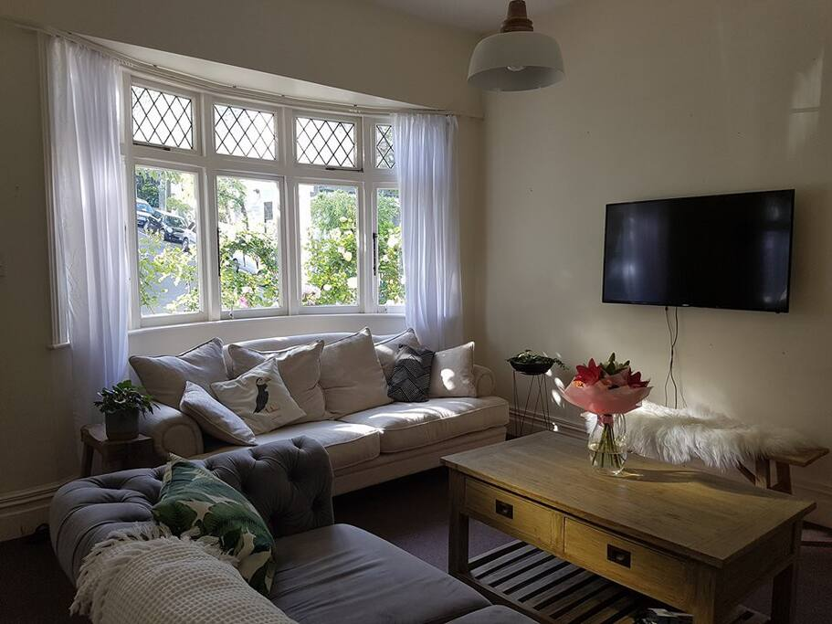 Our lounge area with the roses through the bay window