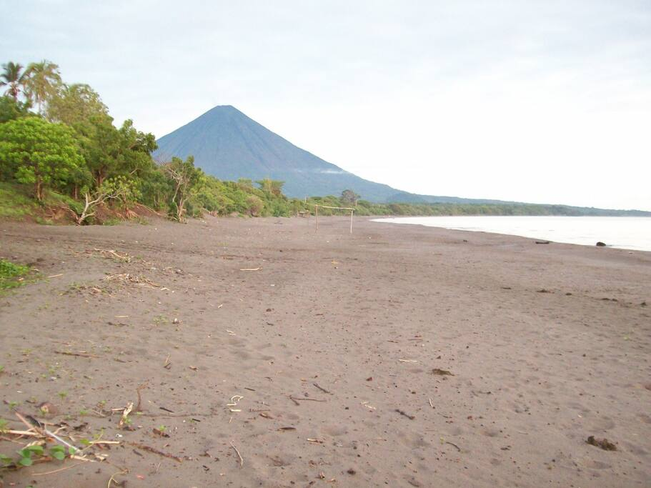 Just a step from your private guest house to the longest stretch of sandy beach between 2 volcanoes - Magical !