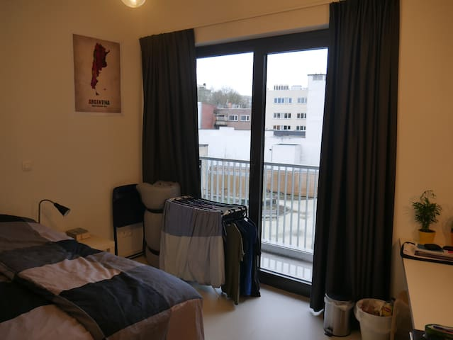 Modern room in Antwerp city with balcony