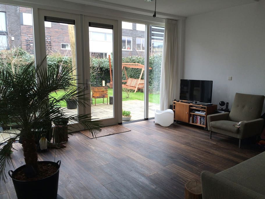 Open living room with two sofa's, a couch, TV, stereo & dvd