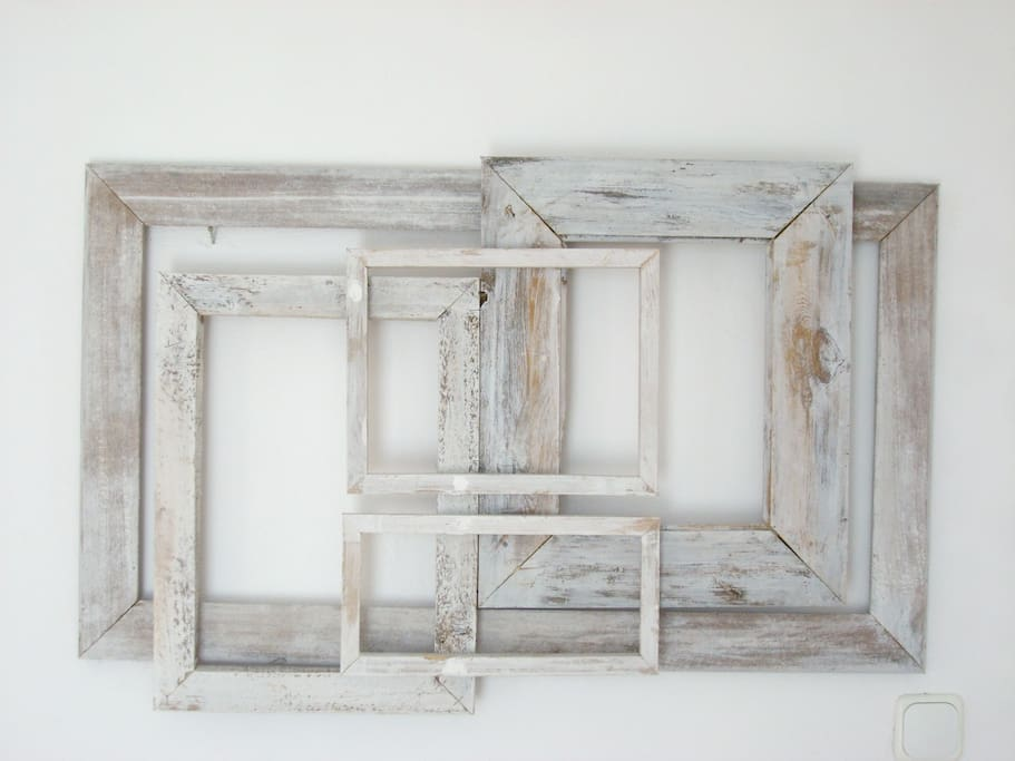 The decoration above the bed, made from recycled wood.