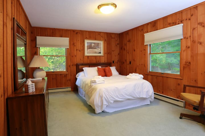 2nd floor Master Bedroom with private bath and additional day bed.  Can sleep a couple with a child easily.