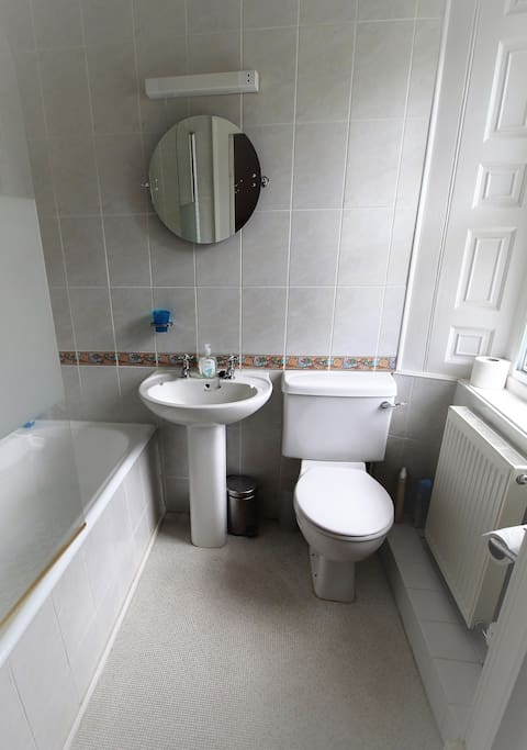 En suite bathroom with shower over the bath