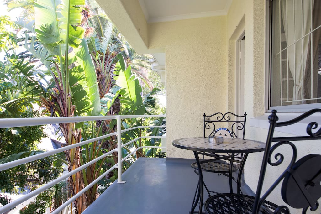 Enjoy some down time on the large balcony overlooking the beautifully maintained garden