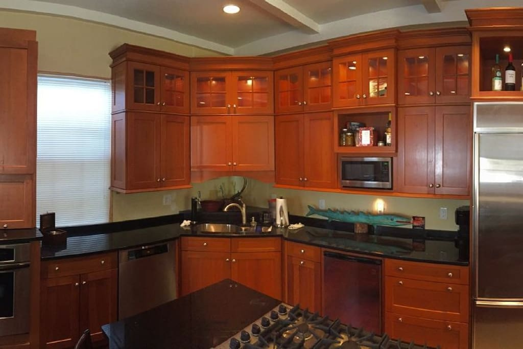 High end custom kitchen with 6 burner Viking cook top and kegerator