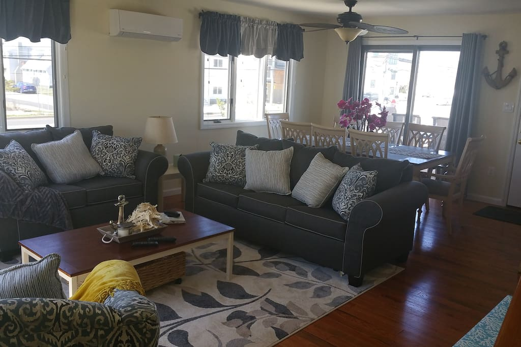 Living Room w/ Open Concept and Bay View