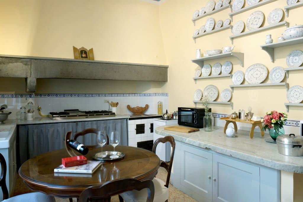 Large kitchen with an antique Carrara white marble countertop