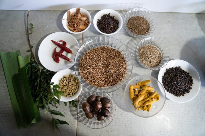 Spices going to make the curry powder