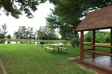Rustic cabin on pond in KOA campground