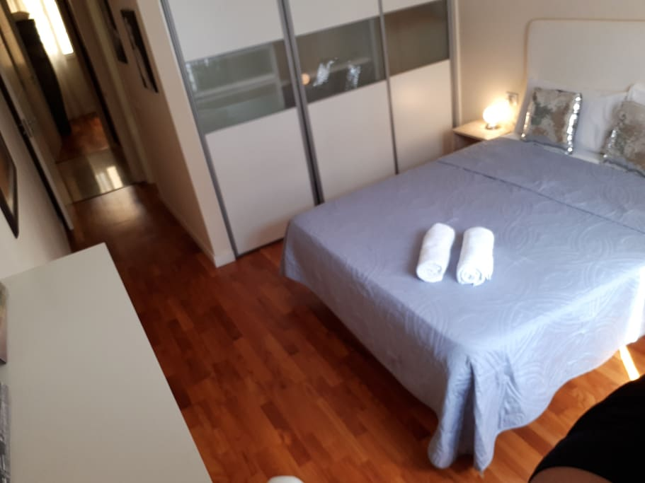Suit with private bathroom . Natural wooden floors.