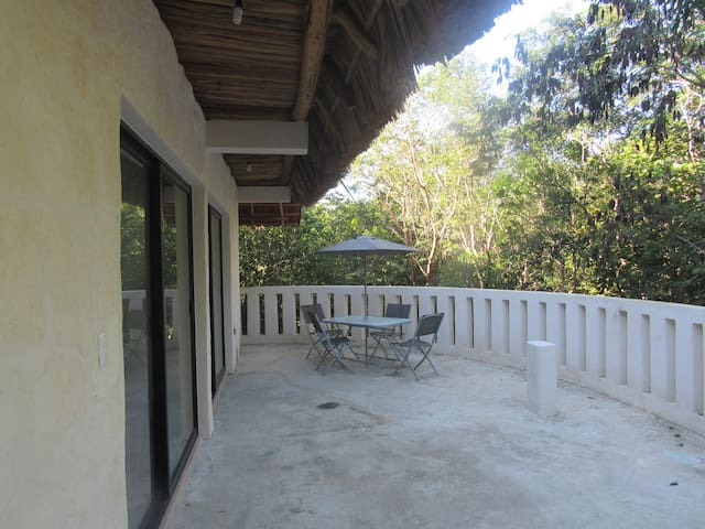 outdoor patio surrounded by trees is great for bird watching and excellent sunsets
