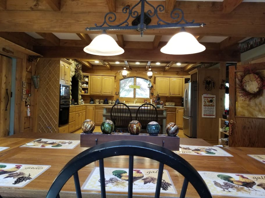Large 17x32 eat in kitchen may be shared with others. Seats up to 10 at main table and 6 more with extra table under island.