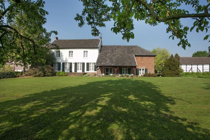 Traditional half-timbered farmhouse in the beautiful, hilly landscape of South-Limburg.