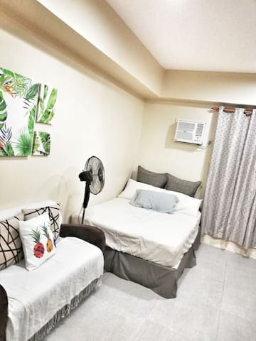 A homey condo unit right next to SM Uptown.