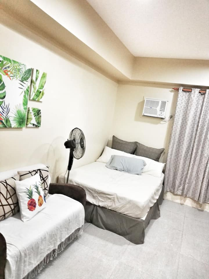 A homey condo next to SM Uptown + Fully-furnished