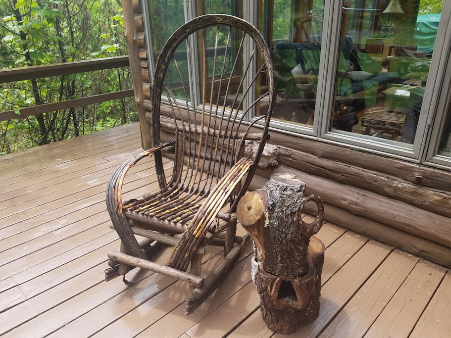 Hand crafted willow chair on front porch