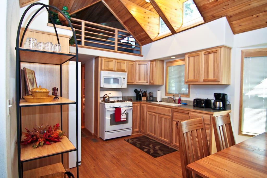 Full kitchen equipped with stove, oven and microwave.