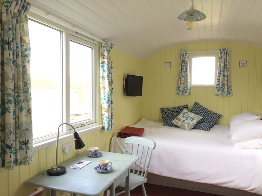 Tea for 2? The hut has 1 double bed, a small dining area, TV/DVD player, DVD's, novels and local info books.