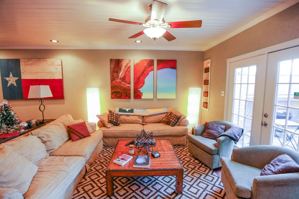 """Hangout in this cozy living area that comfortably seats 8-10. Complete with 65"""" 4K UHD TV & Chromecast. This is a great space for small get togethers!"""