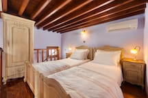 This is the second bedroom. All bed linen are organic and hypoallergenic. Slippers and quality Greek toiletries are provided at no additional charge.