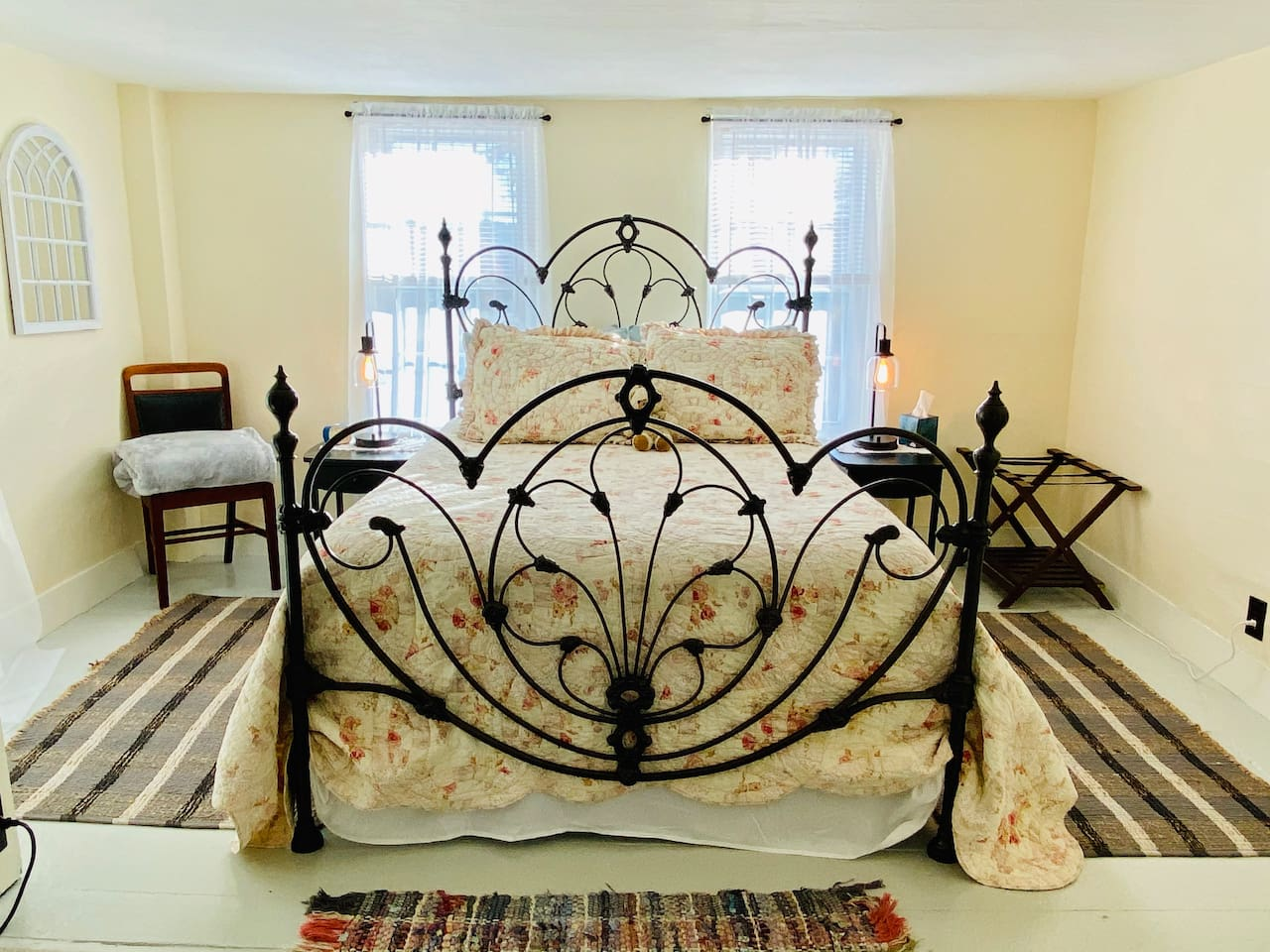 Refinished antique bed frame with queen mattress, soft and firm pillows and cotton bedding.