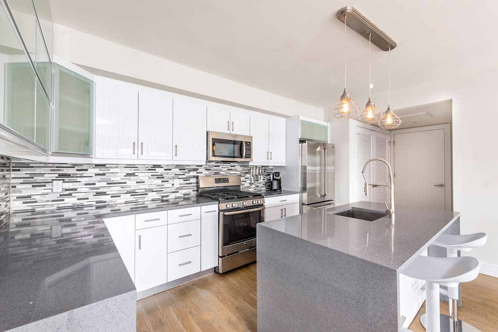 The designer kitchen, with Italian-style cabinets, an elegant glass tile back splash and upscale appliances, will tempt you to stay in and cook.