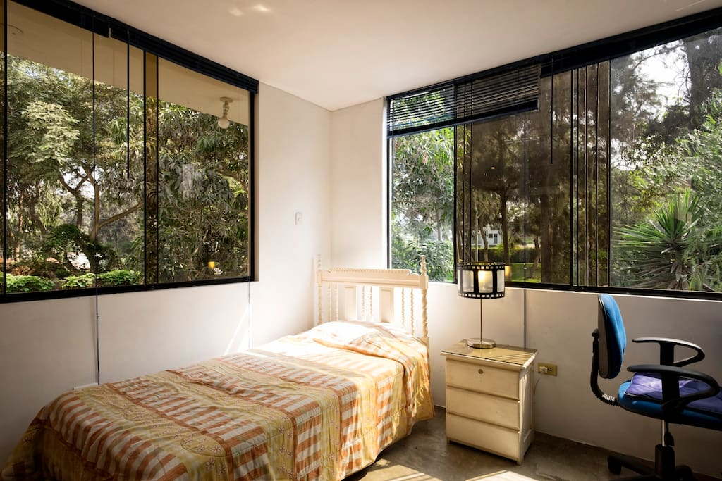Lots of natural light. Bedroom with working desk, closet, big chest and full bathroom