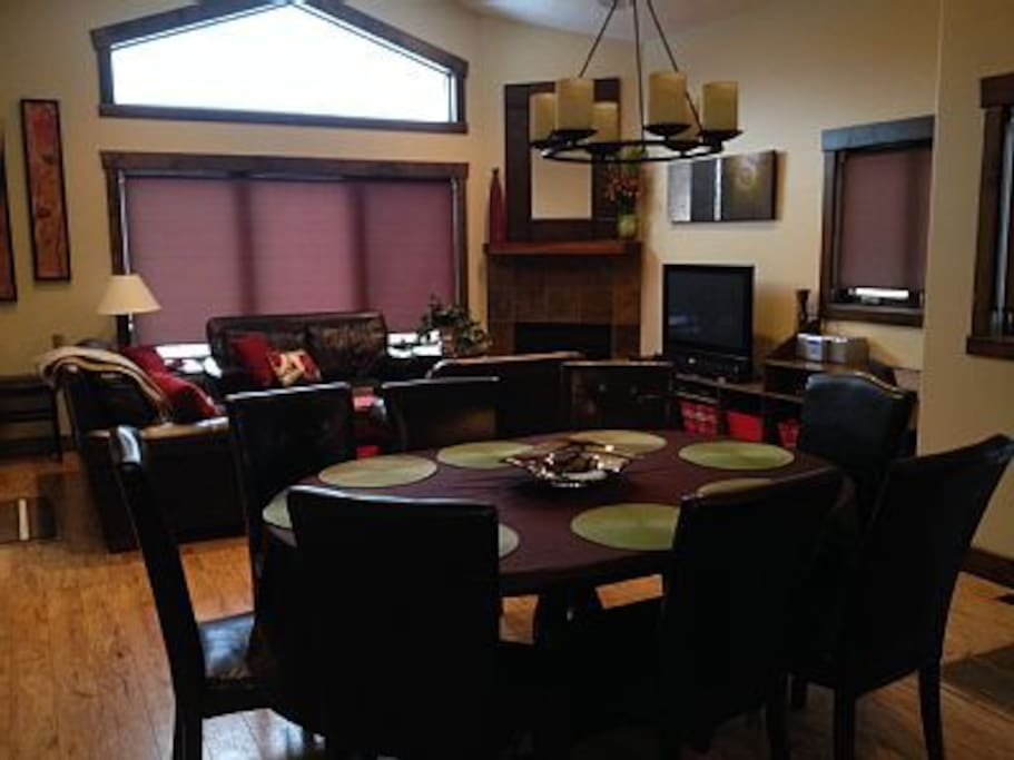 Dining table seats 8, vaulted ceilings, comfy living room, lots of light & space.