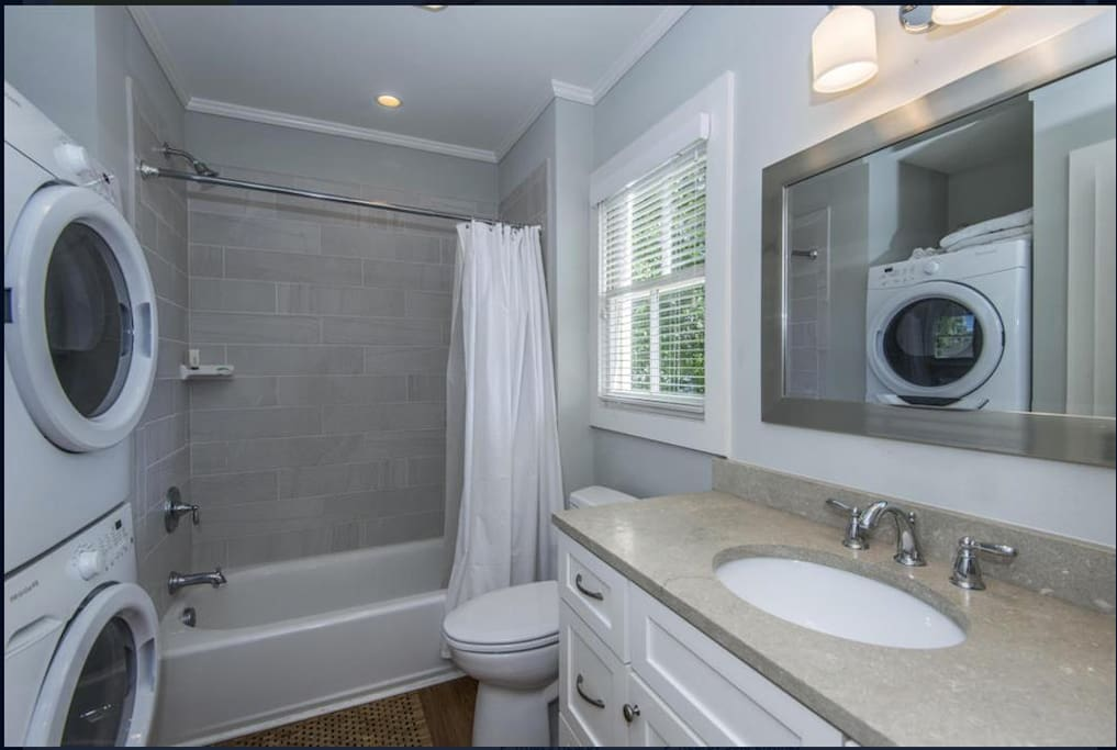Tile bathroom with washer and dryer