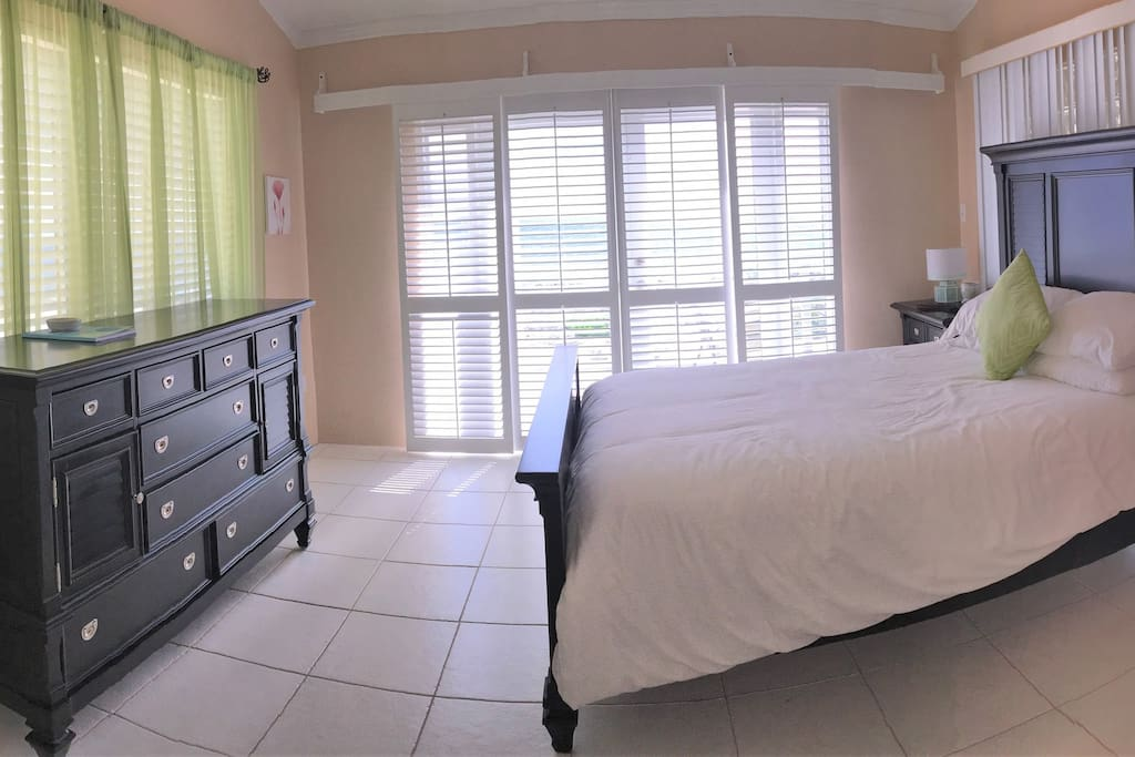 Master Bedroom W/ Devenco Wood Shutters