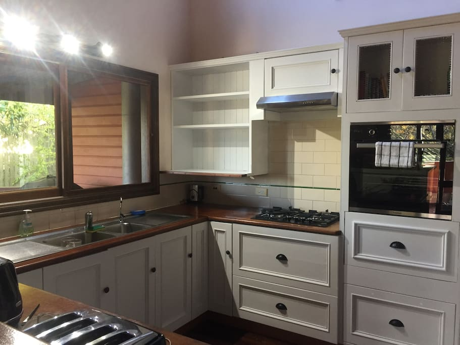 Spacious kitchen with gas cook top, microwave, toaster, kettle and coffee machine.