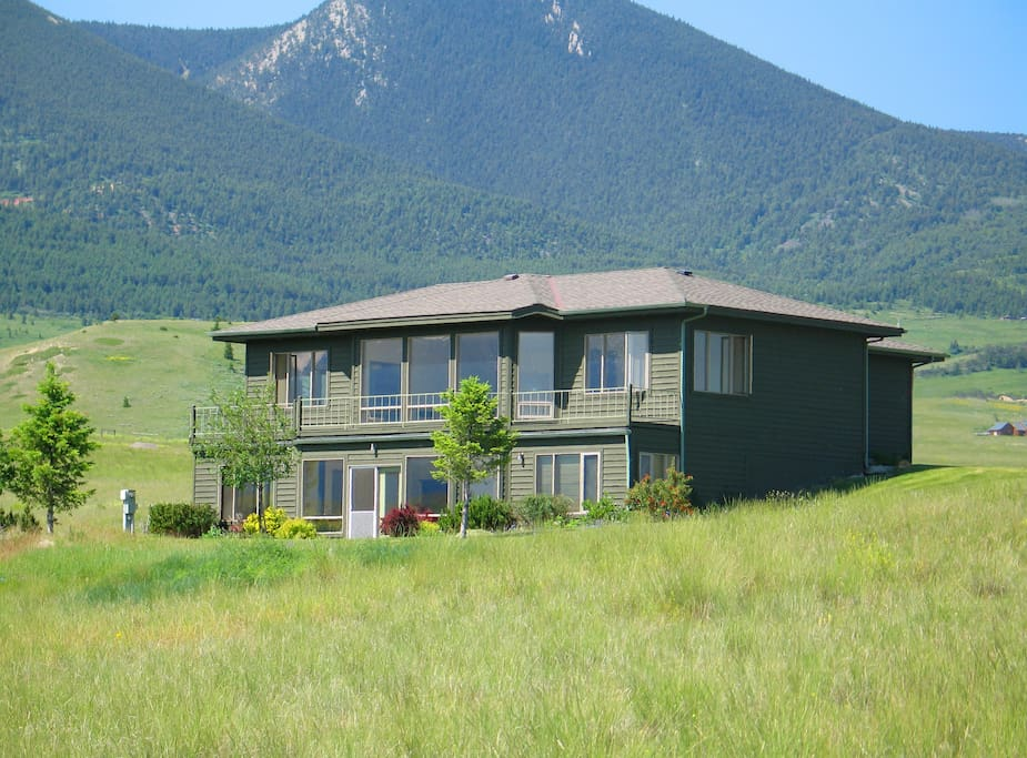 The house is flanked by mountains on its 10 acres of land. The owner also possesses the adjacent 10 acres. So there's plenty of land around the home.