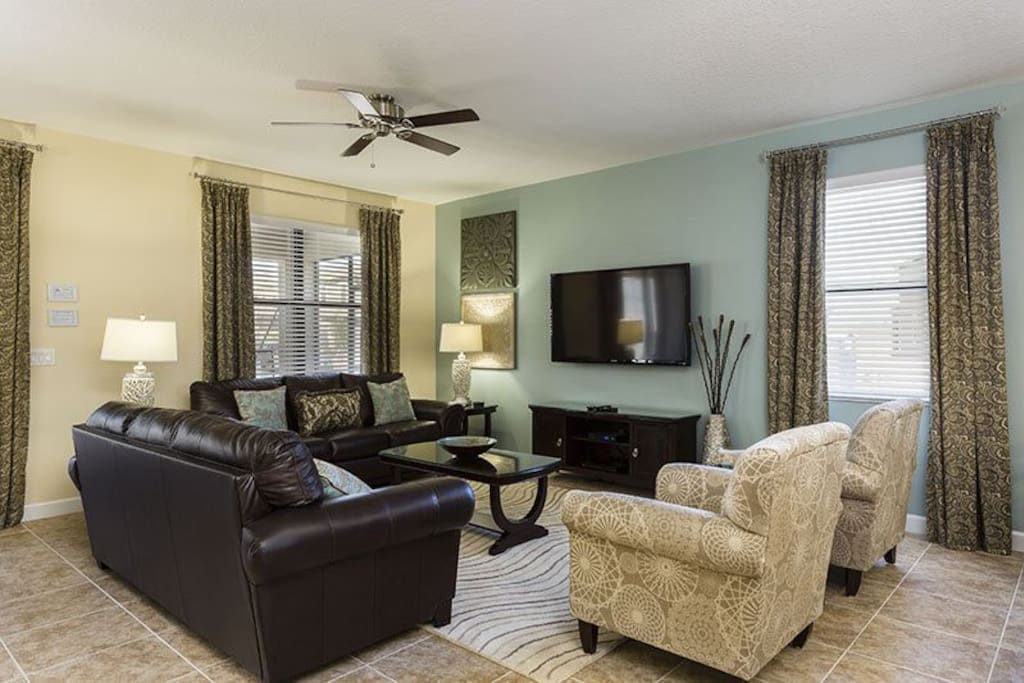 Grand living area with 50-inch plasma TV, Blu-ray player, 1080p HD cable, and  direct pool/patio access