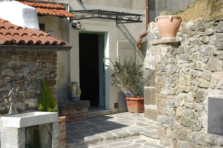 The house has been renovated, situated in a medieval village in Lunigiana.