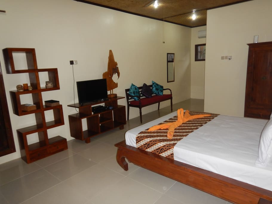 """Teak furnature with 32"""" flat screen TV with International channels"""