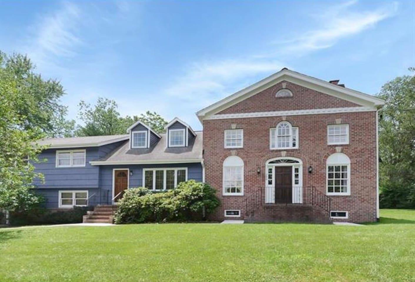 Blue House with a spacious backyard area
