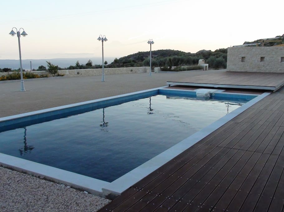 The pool is 10mX5m - it has a shallow part for children (0.55m) and a deeper for adults (1.60m)