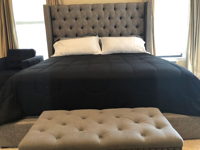 Master room with a king size bed.