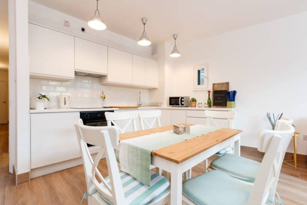 A stunning, brand-new kitchen with dining table for 6