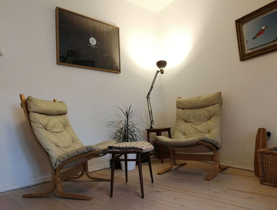 There is a comfy lounge area in the living room with Norwegian retro design furniture.